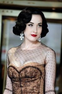 dita von teese wearing pearl earrings