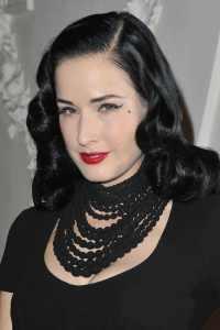 dita von teese wearing a black necklace
