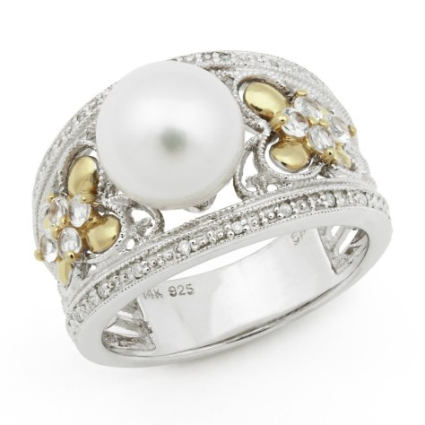 white pearl ring in thick silver setting