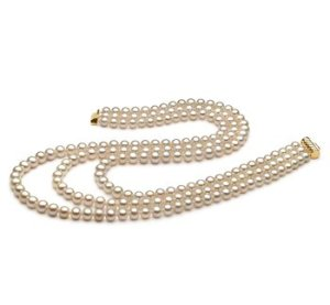 white triple strand of pearls