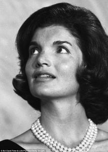Jackie Kennedy wearing a triple strand pearl necklace