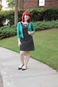 pearl necklace and green blazer