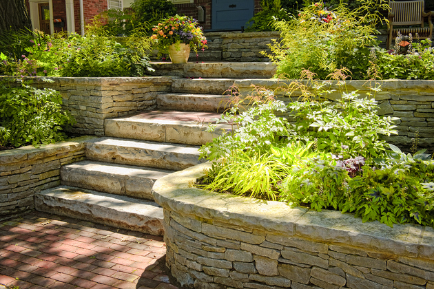 Picture of natural stone landscaping in home garden with stairs