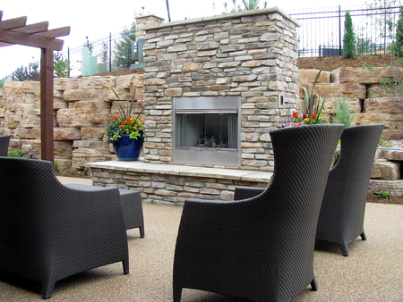Picture of An outdoor fireplace on the back patio with chairs great for entertaining and relaxation