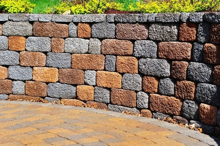 Picture of a retaining Wall and Patio with Landscaping and Pavers