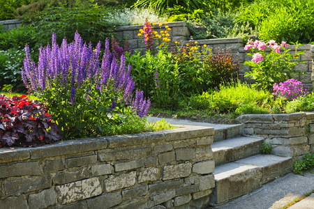 Picture of Natural stone landscaping in home garden with steps and flowerbeds