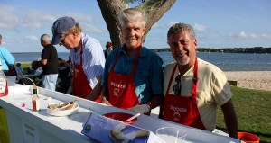 Andrew Lowry, Jim Lowry and Rich Accurso tend the raw bar