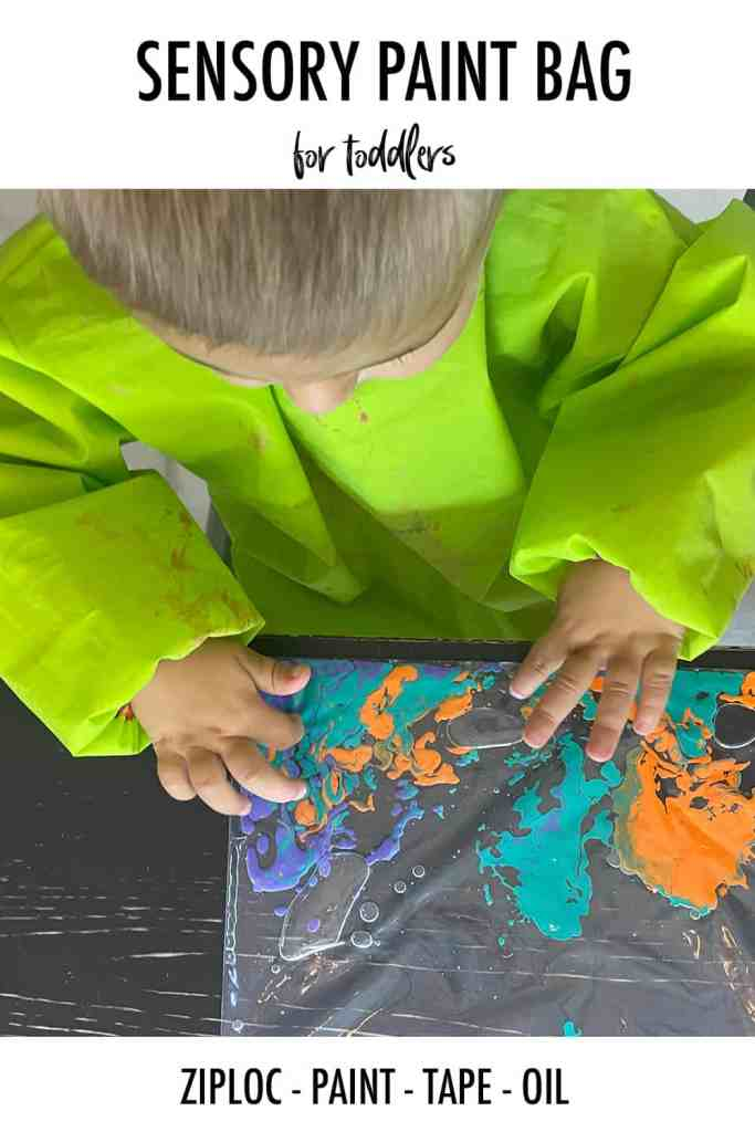 Toddler mixing paint in a bag with baby oil