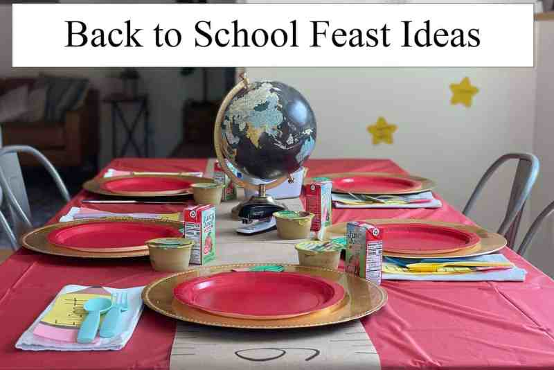 Table set with a globe and place settings with a back to school theme.