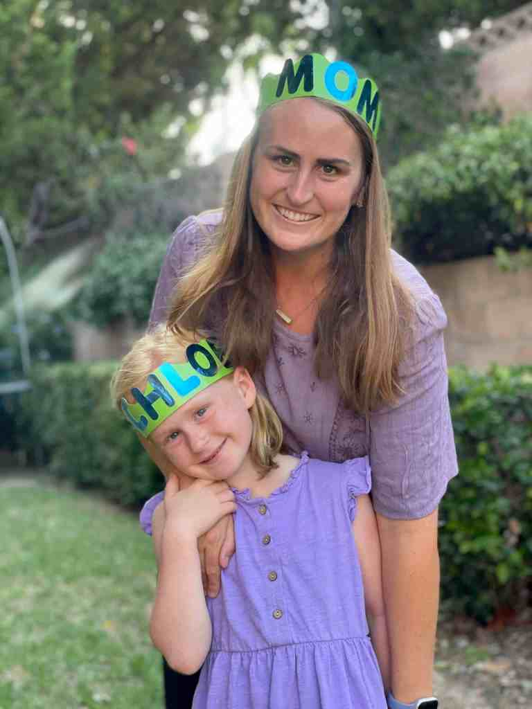 Mother and Child with back to school crowns with their names on them.