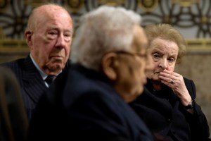 Madeleine Albright and George Shultz listening to Henry Kissinger