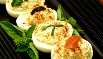 Chicken is the secret ingredient to liven up traditional deviled eggs. Look how pretty they are!