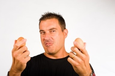 man holding two eggs - My Penis Size Tripled With Just Jelqs And Stretches
