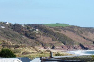 distant side view of beach from bedroom Freshwater East Accommodation
