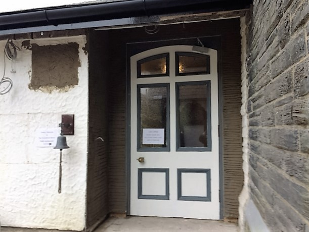 and after: door now undercoated, and surrounding rendered