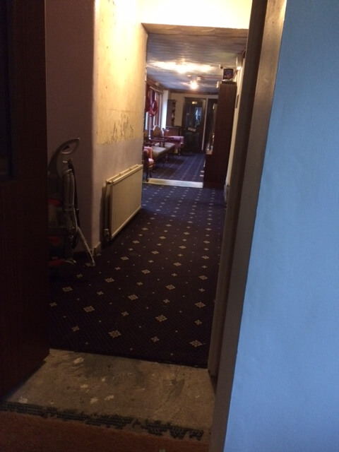 and the reverse view (from the entrance, looking down the long corridor) before it all goes!