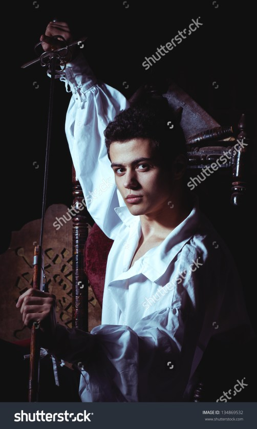 stock-photo-portrait-of-a-romantic-man-with-a-sword-134869532