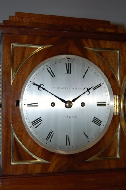 Close up of round silvered brass dial by Thwaites Reed London