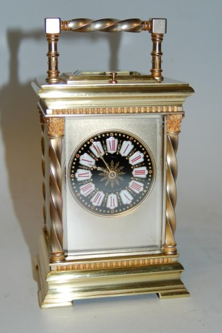 Ornate dial carriage clock