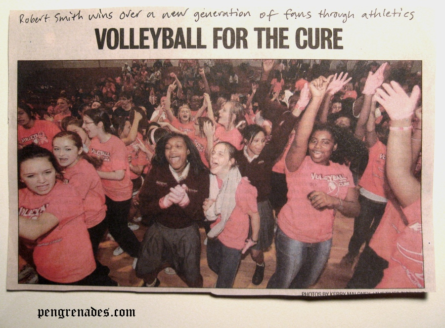 teenage girls wearing pink Cure shirts