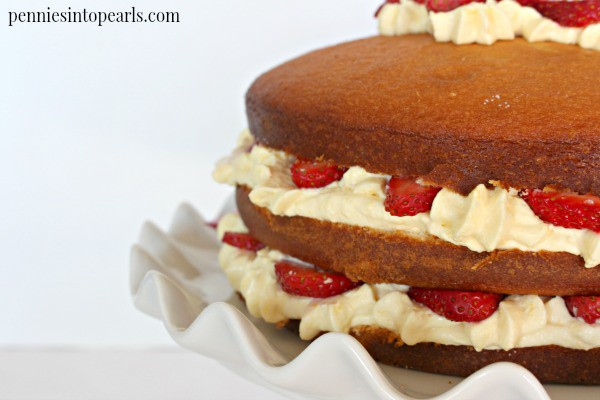 Layered Strawberry Cake Recipe - penniesintopearls.com - Way easier than it looks! White cake recipe layered with fresh strawberries and a quick whipped cheesecake frosting.