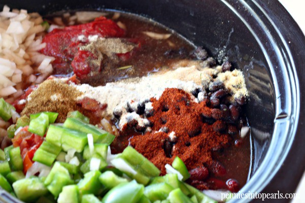 Secret Ingredient Slow Cooker Chili Recipe - penniesintopearls.com - Find out what the secret ingredient is in this slow cooker chili recipe that gives it so much extra flavor! Too late for a slow cooker? You can make this chili recipe in a pot in 10 minutes!
