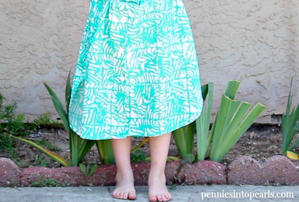 Easy way to take your thrift store find and refashion into a new girl's dress. Easy DIY sewing project to makeover your thrift store find.