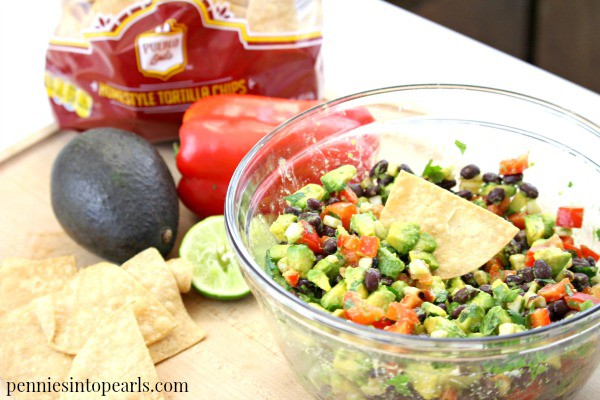 The BEST salsa recipe ever! Easy fresh homemade salsa recipe you can make in only five minutes! This healthy avocado and black bean salsa recipe tastes so good no one will know it's homemade.