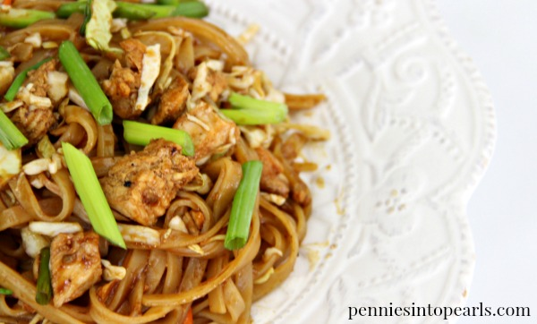 Easy recipe for authentic tasting chicken pad thai to be made in less than 20 minutes! A few secret short cuts make this an easy chicken pad thai recipe on a budget. All fresh ingredients for this quick dinner recipe can be bought for less than $5!