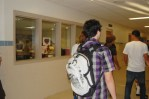 kid with a backpack in the hall