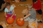 Students carving pumpkins
