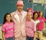 Dr. Leichliter poses with students at Manor Middle School