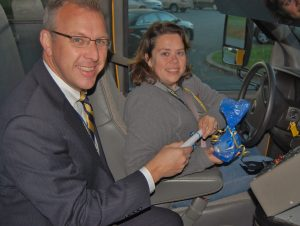 Receiving a gift bag from superintendent Michael Leichliter is bus driver Kelly Ditzler