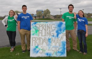Spring Fling organizers, from left, Alisa Herr, Brad Seiger, Nick Kirk and Hannah Willig, pose with the sign.