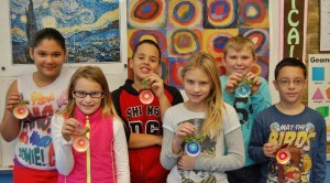 """Hambright Elementary students, from left, Alianis Rentas, Willow Hee, Jaedyn Gardner, Sophia Millhouse, Blake Clutter and Ramon Gonzalez diplay their handmade ornaments, which will be displayed at Lancaster Museum of Art's """"Trees Galore"""" show."""