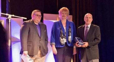 Frerichs, far right, accepts the Allwein Award from Nathan Mains, PSBA executive director, and Lynn Foltz, 2015 recipient.
