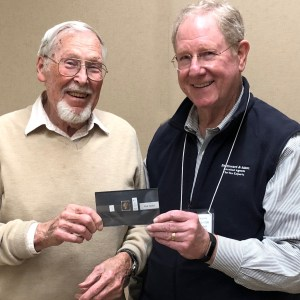 Phil Holock receiving winning stamp from Pres. Jim Southward