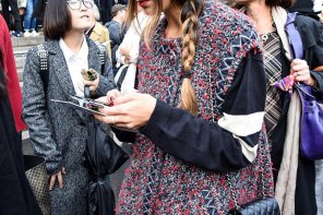 How to #wear #baker boy hat and #sleeveless Chanel coat, #streetstyle #fashion #ParisFashionWeek #Chanel by PeopleandStyles.com
