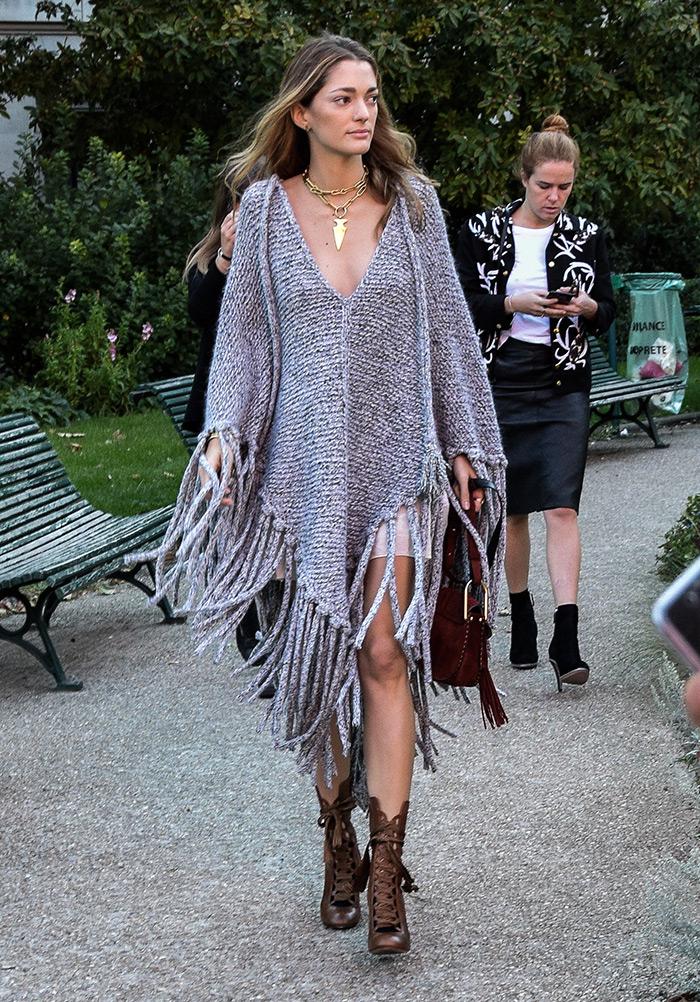 How to wear Chloe woven poncho, Sofia Sanchez de Batek wearing grey woven poncho, Paris Fashion Week street style fashion by PeopleandStyles.com
