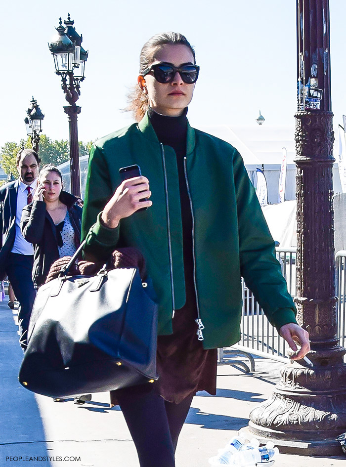 How to wear green bomber jacket and mini skirt, urban look with bomber jacket, street style fashion inspiration from streets of Paris, Paris Fashion Week Spring Summer