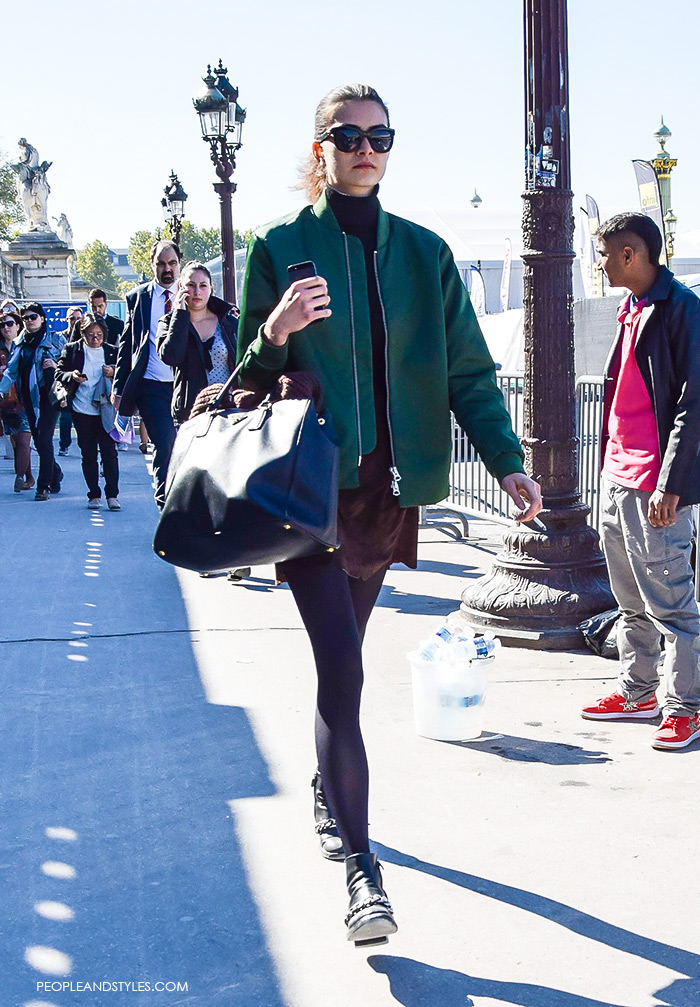 How to wear green bomber jacket, turtleneck, brown mini skirt, Prada tote bag and biker boots. Model off duty look, street style fashion Paris, what to wear now