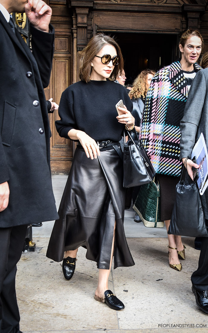 Women's fashion: street style Paris wear to work outfit inspiration Pinterest leather midi skirt side slit and Gucci kangaroo fur lined slippers