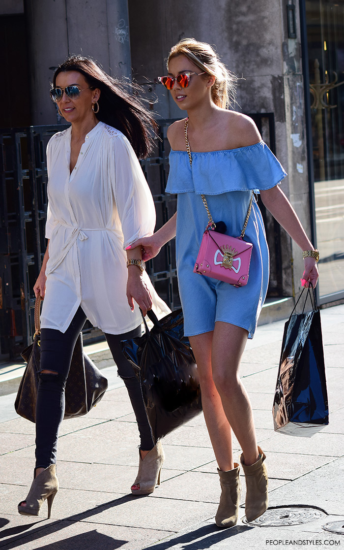 Street style summer women's fashion, how to wear off the shoulder light blue denim dress picture Pinterest mini denim dress, mirror sunglasses and ankle boots