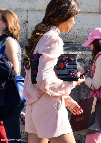 Street Look: Nergin Mirsalehi in a Pink Jumpsuit and Black Boots during Paris Fashion Week
