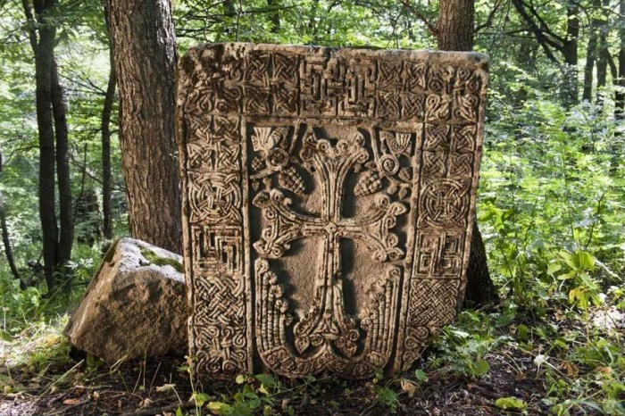 Medieval Armenian khachkar (Cross-stone) in the forest near the town of Lachin