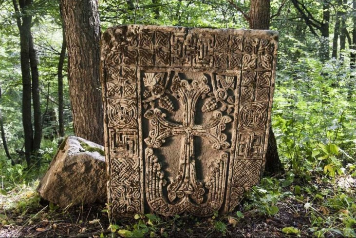 Medieval khachkar in the woods near the town of Lachin