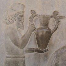 An Armenian tribute bearer carrying a metal vessel with griffin handles. Fifth century BC