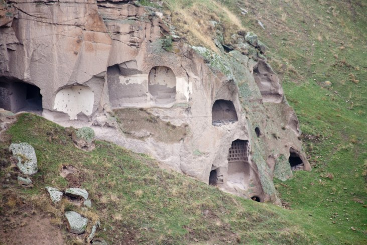 Ancient rock-carved village in Ani. Erosion over the centuries have exposed home interiors.