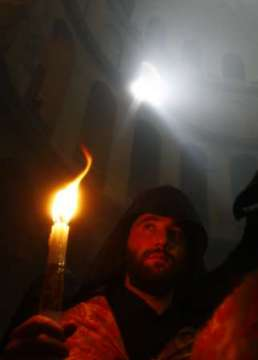 Armenian monk with the holy fire, Jerusalem