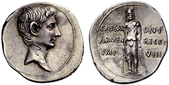 Roman Silver Denarius of Augustus (27 B.C.E.-14 C.E.), in Commemoration of the conquest of Armenia. On the flip-side: an Armenian Bowman, standing facing, holding spear in right hand and resting left on a bow set on the ground. Notice the Mithraic cap he is wearing.